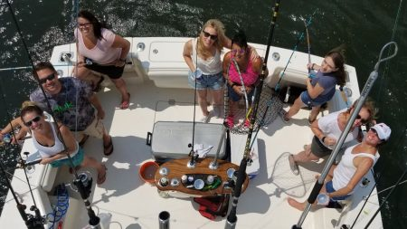 Pink Ribbon Women's Fluke Fishing Tournament on boat